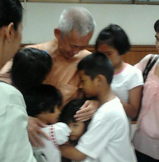 Ampol Tangnopakuls says goodbye to his family after being sentenced