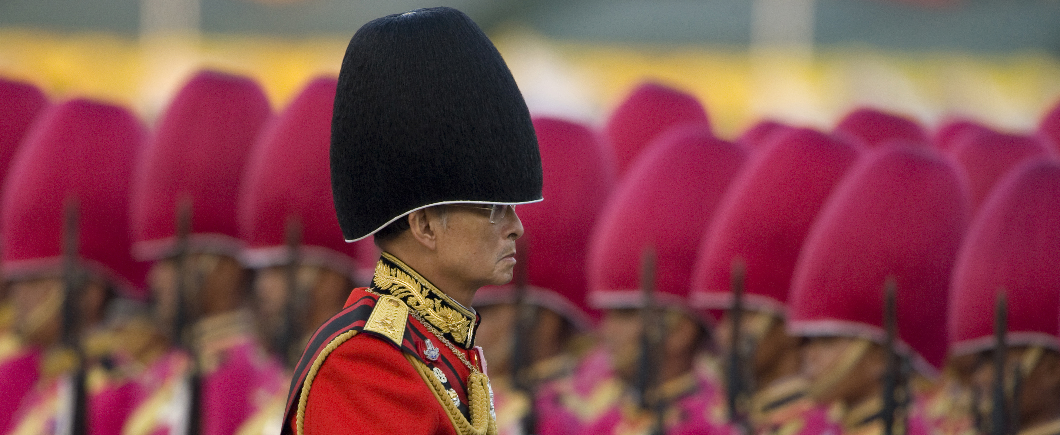 King Bhumibol Adulyadej trooping the colour in 2008
